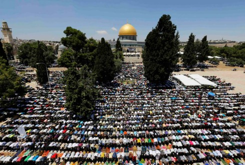 Palestinian worshippers pray in front of the Dome of the Rock in Jerusalem's Old City, during Ramadan