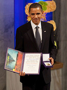 Obama_with_the_Nobel_Prize_medal_and_diploma