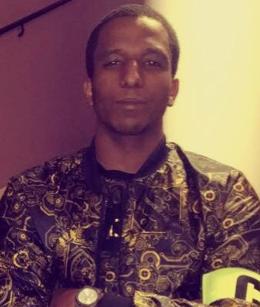 Merhawi Aregai, lägg märke till att han bär en Katensbindel.